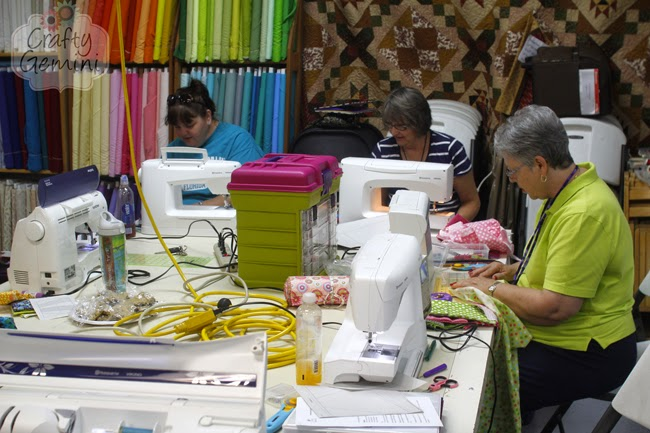 ladies sewing at quilt shop