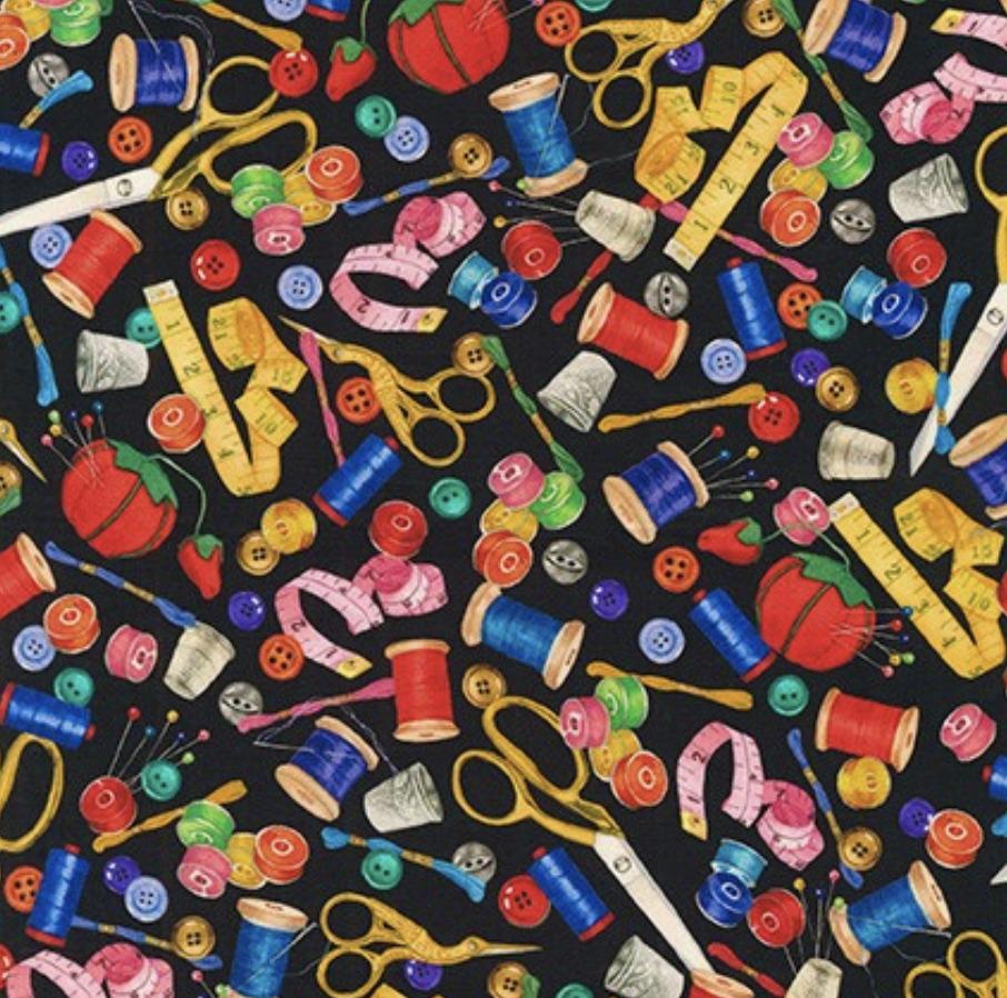 sewing buddies on black cotton fabric by robert kaufman fabrics